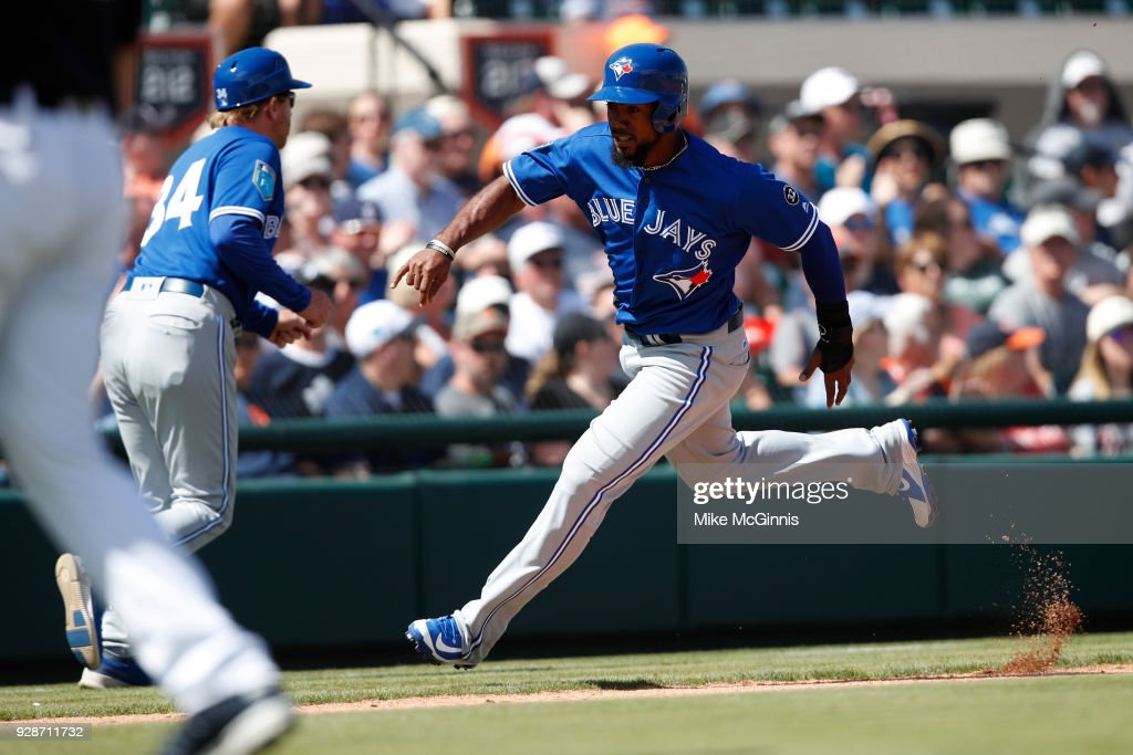 Teoscar Hernandez #37 of the Toronto Blue Jays heads for home to score on an RBI double by Danny Jansen during the second inning of the spring training game against the Detroit Tigers at Joker Marchant Stadium on March 07, 2018 in Lakeland, Florida.