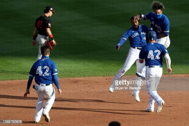 Teoscar Hernandez of the Toronto Blue Jays is celebrates with teammates after hitting a walk-off two run single to defeat the Baltimore Orioles 6-5...