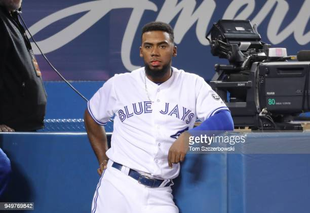 Teoscar Hernandez of the Toronto Blue Jays looks on from the top step of the dugout during MLB game action against the Kansas City Royals at Rogers...