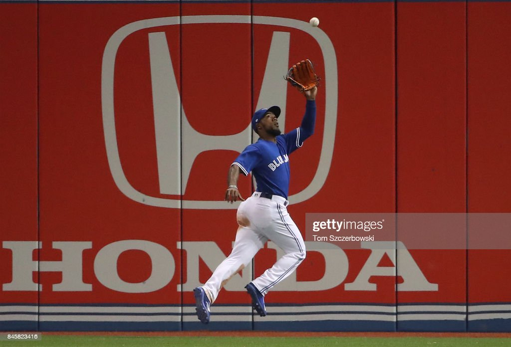 Teoscar Hernandez #36 of the Toronto Blue Jays makes a running catch in the eighth inning during MLB game action against the Baltimore Orioles at Rogers Centre on September 11, 2017 in Toronto, Canada.