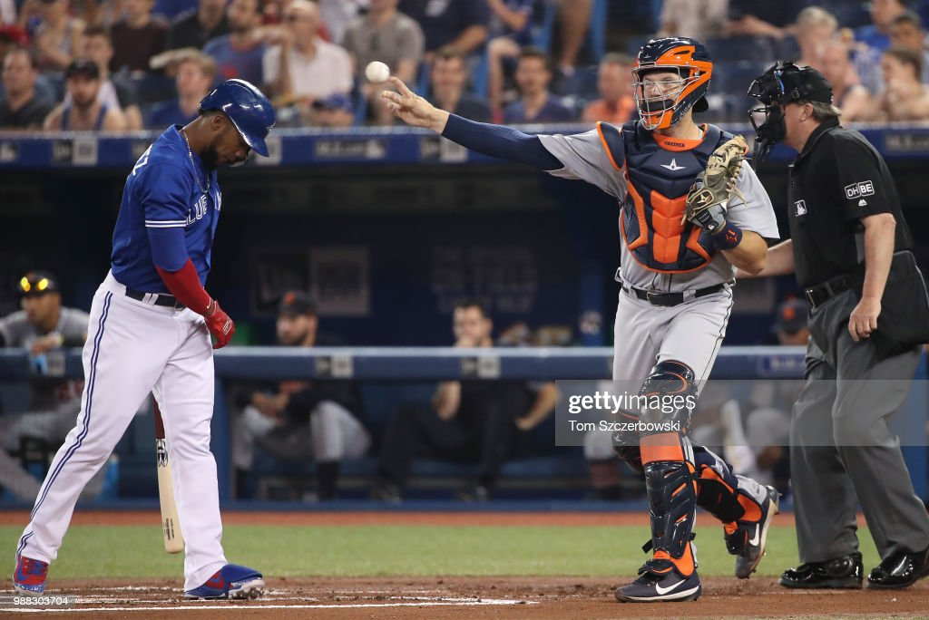 Teoscar Hernandez #37 of the Toronto Blue Jays reacts as he strikes out in the first inning during MLB game action as Grayson Greiner #17 of the Detroit Tigers throws down to third base at Rogers Centre on June 30, 2018 in Toronto, Canada.