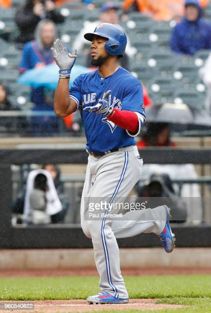 Teoscar Hernandez of the Toronto Blue Jays runs home celebrating his home run in the 4th inning of an interleague MLB baseball game against the New...