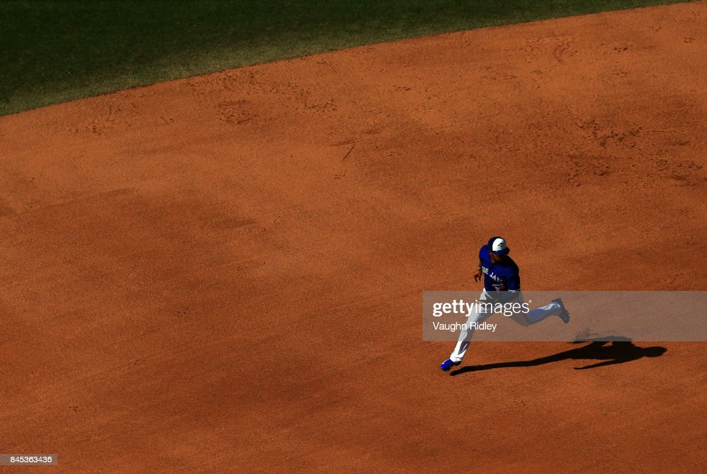 Teoscar Hernandez #37 of the Toronto Blue Jays runs to third base on a single by Darwin Barney #18 in the seventh inning during MLB game action against the Detroit Tigers at Rogers Centre on September 10, 2017 in Toronto, Canada.