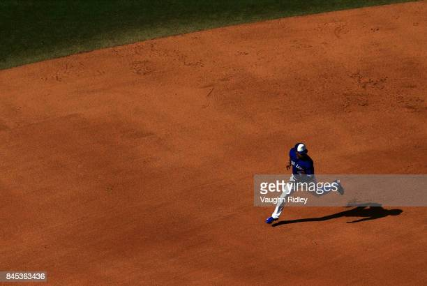 Teoscar Hernandez of the Toronto Blue Jays runs to third base on a single by Darwin Barney in the seventh inning during MLB game action against the...