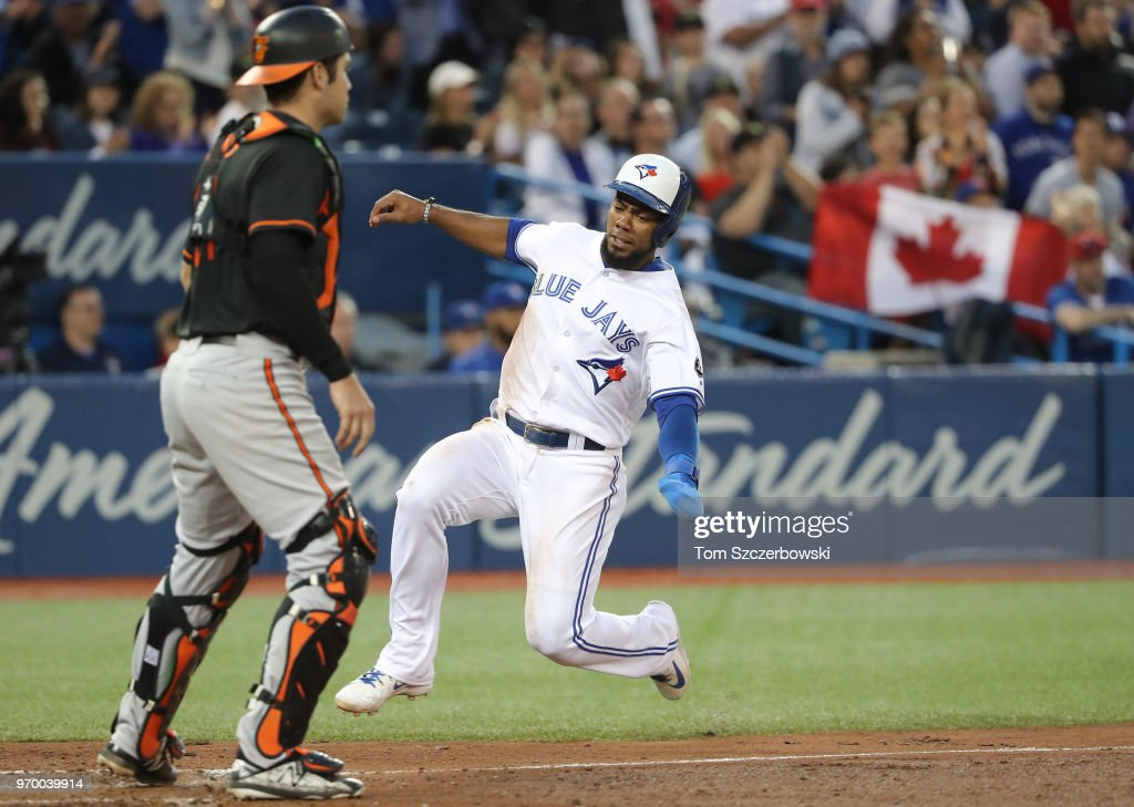 Teoscar Hernandez #37 of the Toronto Blue Jays slides home safely to score a run in the sixth inning during MLB game action against the Baltimore Orioles at Rogers Centre on June 8, 2018 in Toronto, Canada.