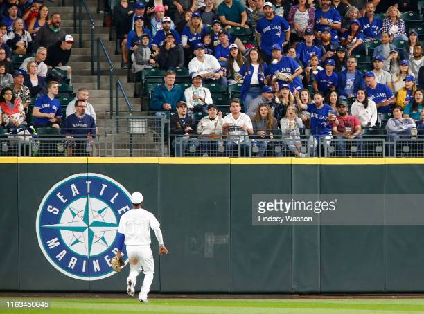 Teoscar Hernandez of the Toronto Blue Jays watches the home run by J.P. Crawford of the Seattle Mariners fly into the stands in the fifth inning at...