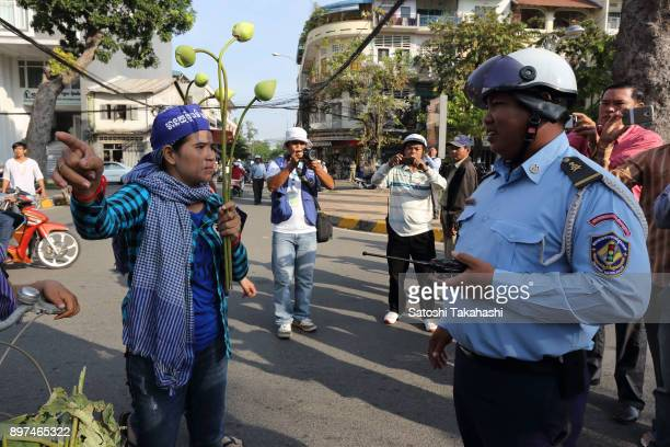 Tep Vanny one of Cambodia's most prominent land rights activists symbol of peaceful activism in Cambodia confronts police during a demonstration...