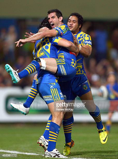Tepai Moeroa of the Eels celebrates his try with Isaac De Gois and Bureta Faraimo during the round 22 NRL match between the Parramatta Eels and the...