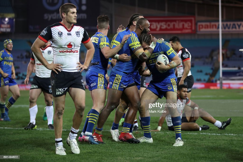 Tepai Moeroa of the Eels celebrates with his team mates after scoring a try during the round 13 NRL match between the Parramatta Eels and the New Zealand Warriors at ANZ Stadium on June 2, 2017 in Sydney, Australia.