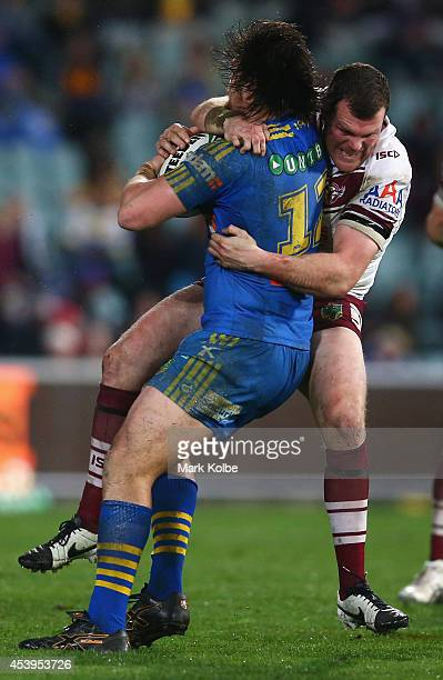 Tepai Moeroa of the Eels is hit high in tackle by Jason King of the Sea Eagles during the round 24 NRL match between the Parramatta Eels and the...