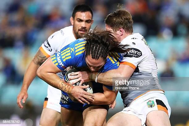 Tepai Moeroa of the Eels is tackled by Christopher Lawrence of the Tigers during the round 21 NRL match between the Parramatta Eels and the Wests...
