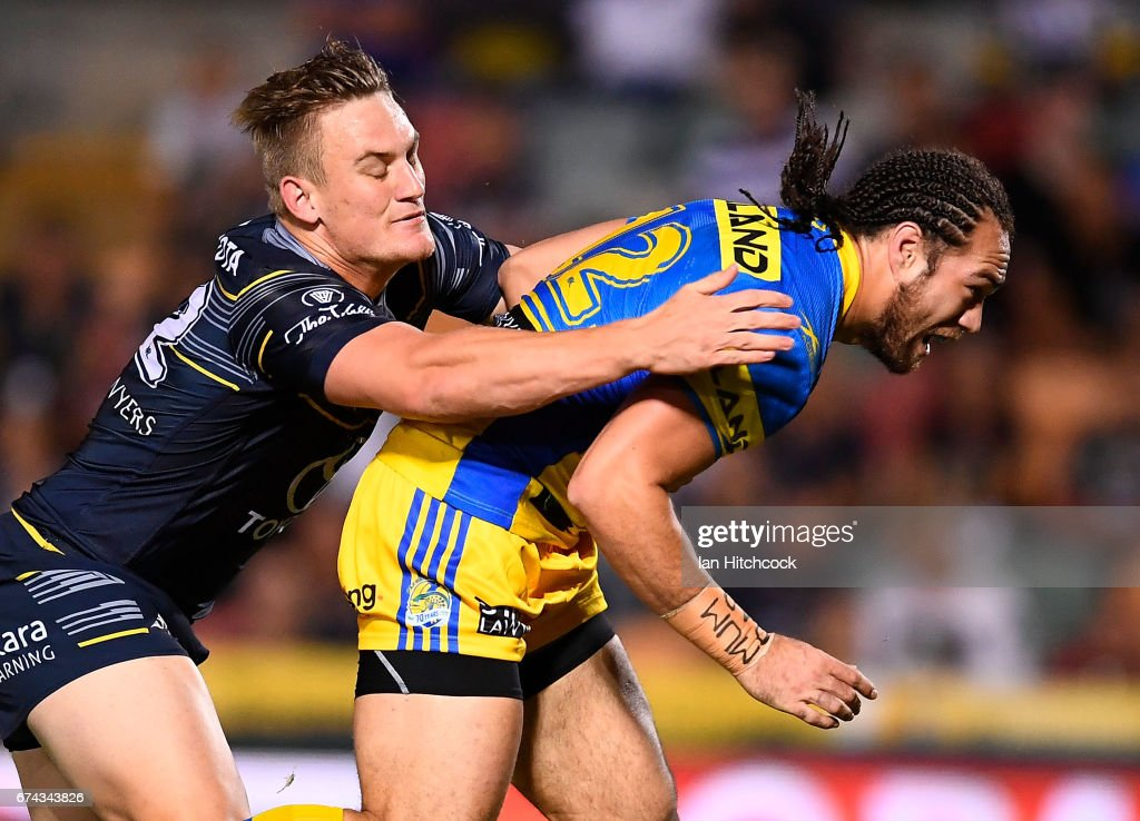 Tepai Moeroa of the Eels is tackled by Coen Hess of the Cowboys during the round nine NRL match between the North Queensland Cowboys and the Parramatta Eels at 1300SMILES Stadium on April 28, 2017 in Townsville, Australia.