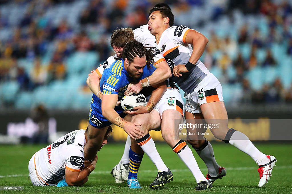 Tepai Moeroa of the Eels is tackled by the Tigers defence during the round 21 NRL match between the Parramatta Eels and the Wests Tigers at ANZ Stadium on July 30, 2016 in Sydney, Australia.