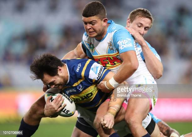 Tepai Moeroa of the Eels is tackled by the Titans defence during the round 21 NRL match between the Parramatta Eels and the Gold Coast Titans at ANZ...