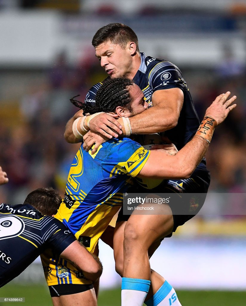 Tepai Moeroa of the Eels is tackled high by Corey Jensen of the Cowboys during the round nine NRL match between the North Queensland Cowboys and the Parramatta Eels at 1300SMILES Stadium on April 28, 2017 in Townsville, Australia.