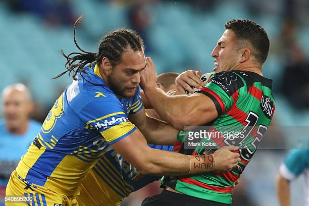 Tepai Moeroa of the Eels tackles Sam Burgess of the Rabbitohs during the round 15 NRL match between the South Sydney Rabbitohs and the Parramatta...