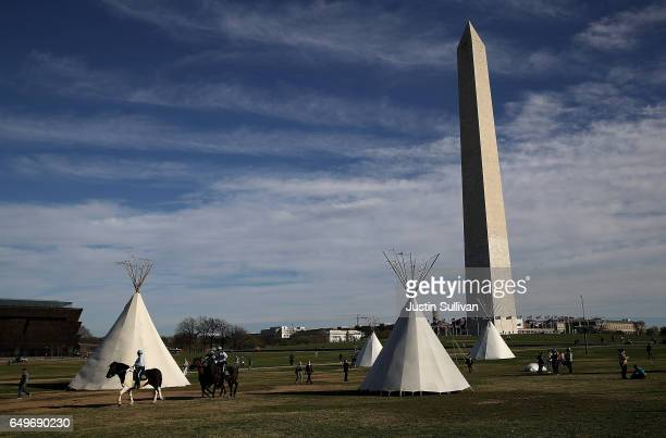 Tepees set up by Dakota Access Pipeline protesters stand next to the Washington Monument on March 8, 2017 in Washington, DC. Indigenous rights...