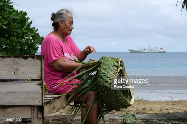 Tepola Raobu weaves a Tapola or basket on August 15 2018 in Funafuti Tuvalu The basket is made with leaves from the Launiu tree and is used for...