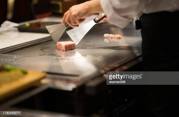 teppanyaki chef cooking marble kobe beef wagyu - silver service stock pictures, royalty-free photos & images