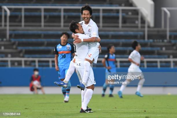 Teppei Usui and Junya Imase of Kataller Toyama celebrate their fourth goal during the J.League Meiji Yasuda J3 match between YSCC Yokohama and...