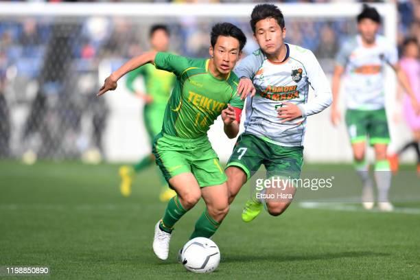 Teppei Yachida of Teikyo Nagaoka and Kuryu Matsuki of Aomori Yamada compete for the ball during the 98th All Japan High School Soccer Tournament semi...