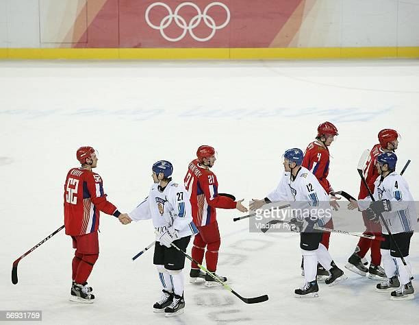Teppo Numminen of Finland greets Russian players after Finland won against Russia in the semi final of the men's ice hockey match between Finland and...