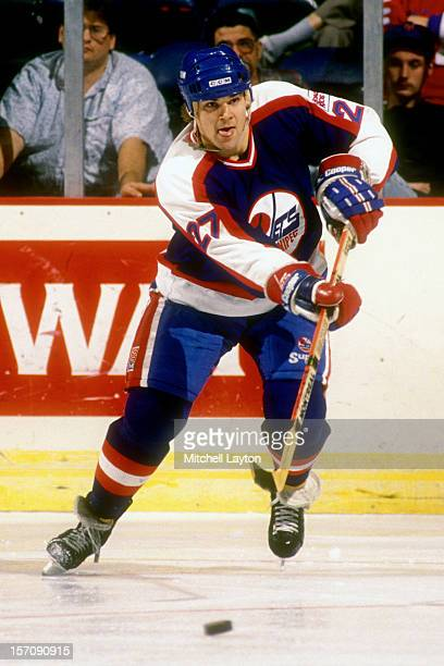 Teppo Numminen of the Winnipeg Jets passes the puck during a hockey game against the Washington Capitals on January 23 1990 at Capital Centre in...