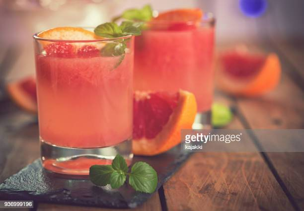 tequila paloma cocktail with fresh grapefruit - grapefruit red stock pictures, royalty-free photos & images