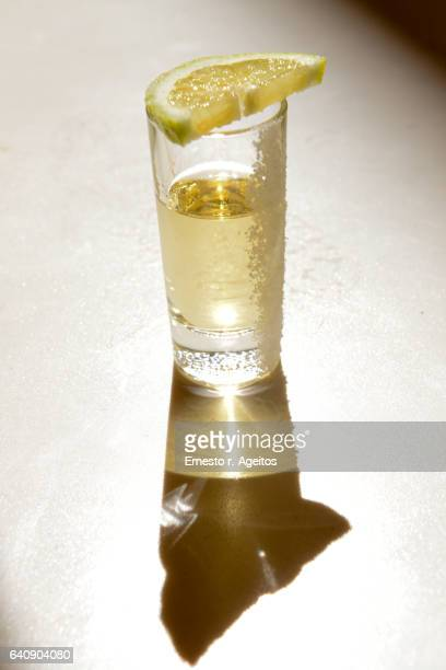 Tequila shot with salt and a lemon slice