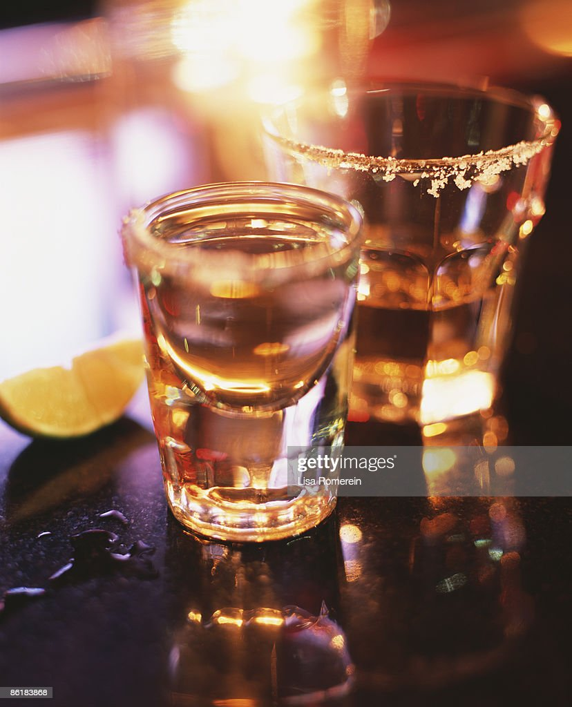 Tequila shots on the bar with salt and lime : Stock Photo