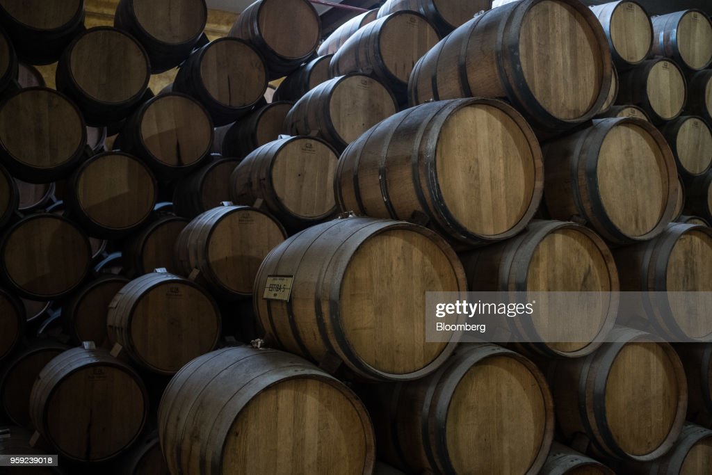 Tequila sits in barrels to age at the Becle SAB Jose Cuervo distillery in the town of Tequila, Jalisco state, Mexico, on Thursday, May 3, 2018. Jose Cuervo sales are benefiting from the trend toward premium spirits, with solid volume and higher average prices driving mid- to high-single-digit top-line growth.Photographer: Mauricio Palos/Bloomberg via Getty Images