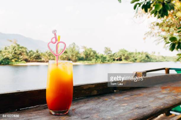 Tequila sunrise by the river