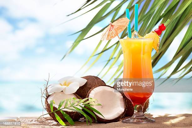 tequila sunrise cocktail on the beach - tropical fruit stock pictures, royalty-free photos & images