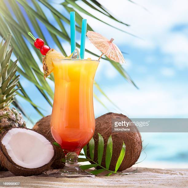 tequila sunrise cocktail on the beach - rum stock pictures, royalty-free photos & images