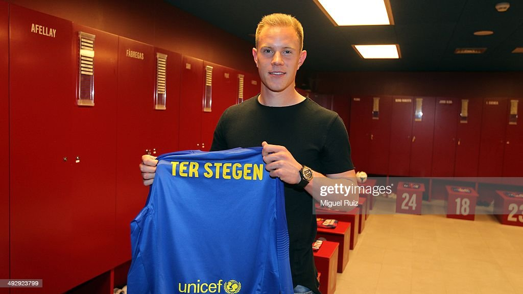 Ter Stegen, new FC Barcelona goalkeeper poses for the camera with his shirt after signing his contract with the Club at Camp Nou on May 22, 2014 in Barcelona, Spain.