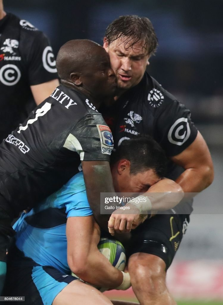Tera Mtembu and Etienne Oosthuizen of the Cell C Sharks tackling Jesse Kriel of the Vodacom Bulls during the Super Rugby match between Cell C Sharks and Vodacom Bulls at Growthpoint Kings Park on June 30, 2017 in Durban, South Africa.