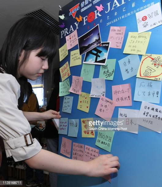 Terai Ayomi post a blessing note to the board during a group of youths starting with a joint fundraising charity sale in the Cityview with the...
