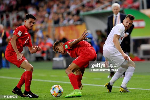 Terai Bremond of Tahiti competes with Adrian Gryszkiewicz of Poland competes with during the FIFA U20 World Cup match between Poland and Tahiti on...