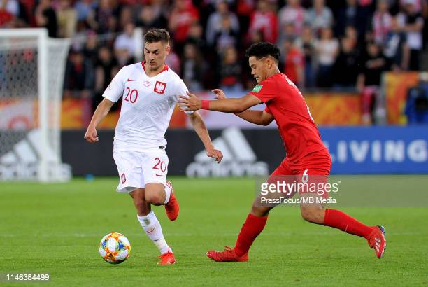 Terai Bremond of Tahiti competes with Marcel Zylla of Poland com during the FIFA U20 World Cup match between Poland and Tahiti on May 26 2019 in Lodz...