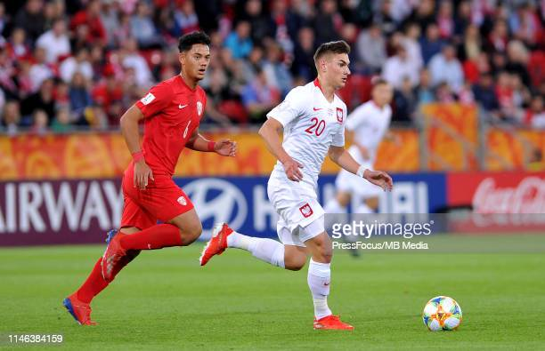 Terai Bremond of Tahiti competes with Marcel Zylla of Poland during the FIFA U20 World Cup match between Poland and Tahiti on May 26 2019 in Lodz...