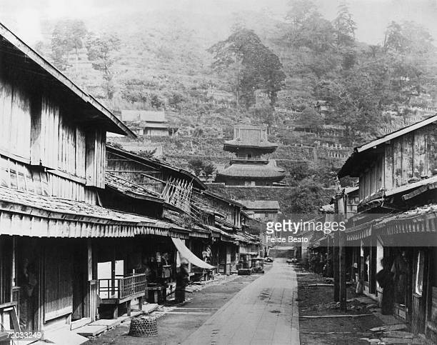Teramachi or Temple Street in Nagasaki leading to a hillside cemetery mid 1860s