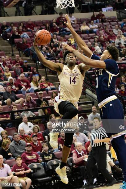 Terance Mann guard Florida State University Seminoles reaches for two points against James Banks III forward/center Georgia Tech Yellow Jackets in an...