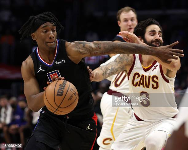 Terance Mann of the LA Clippers and Ricky Rubio of the Cleveland Cavaliers in the fourth quarter at Staples Center on October 27, 2021 in Los...