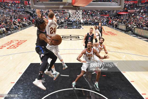 Terance Mann of the LA Clippers drives to the basket and passes the ball against the Cleveland Cavaliers on October 27, 2021 at STAPLES Center in Los...