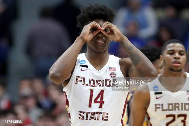 Terance Mann of the Florida State Seminoles celebrates the play against the Murray State Racers in the second half during the second round of the...