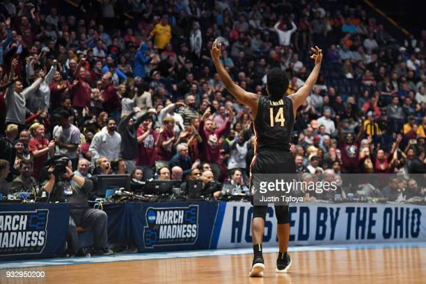 Terance Mann of the Florida State Seminoles celebrates with fans against the Missouri Tigers in the first round of the 2018 NCAA Men's Basketball...