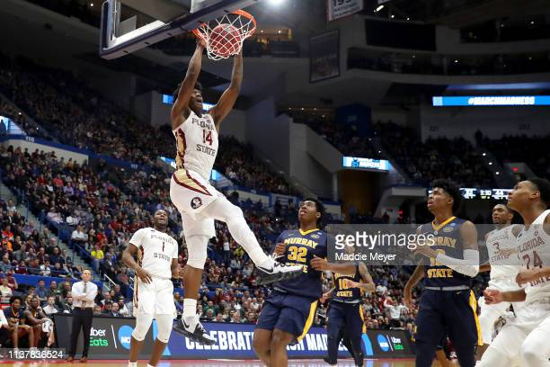 Terance Mann of the Florida State Seminoles dunks the ball against the Murray State Racers in the first half during the second round of the 2019 NCAA...