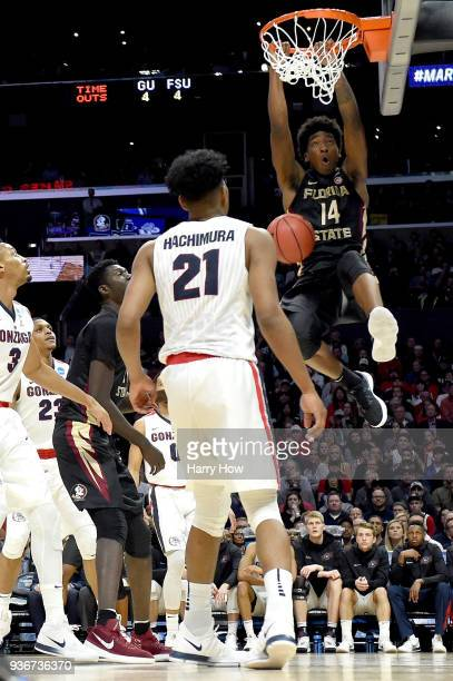 Terance Mann of the Florida State Seminoles dunks the ball against Rui Hachimura of the Gonzaga Bulldogs in the first half in the 2018 NCAA Men's...