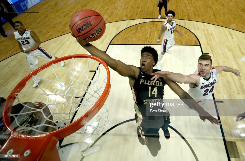 Terance Mann #14 of the Florida State Seminoles goes up for a shot against Corey Kispert #24 of the Gonzaga Bulldogs in the second half in the 2018 NCAA Men's Basketball Tournament West Regional at Staples Center on March 22, 2018 in Los Angeles, California.