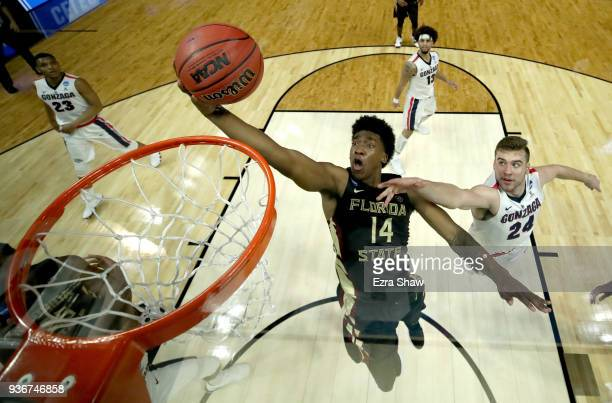 Terance Mann of the Florida State Seminoles goes up for a shot against Corey Kispert of the Gonzaga Bulldogs in the second half in the 2018 NCAA...